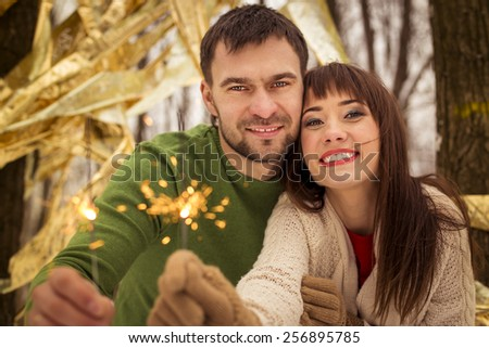 lovely young couple hugging in winter - stock photo