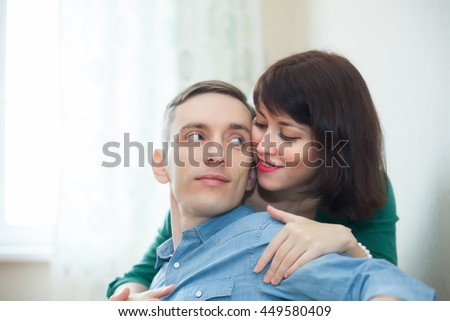 Lovely young couple on   couch at home.