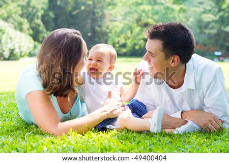 lovely young family in park - stock photo