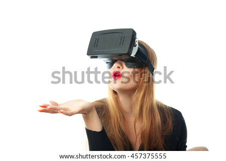 lovely young Girl in virtual reality helmet isolated on white background. VR glasses. Third dimension. Virtual reality helmet.