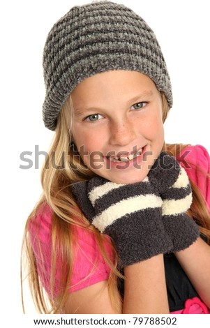 Lovely young girl kid in woolen hat and mittens - stock photo