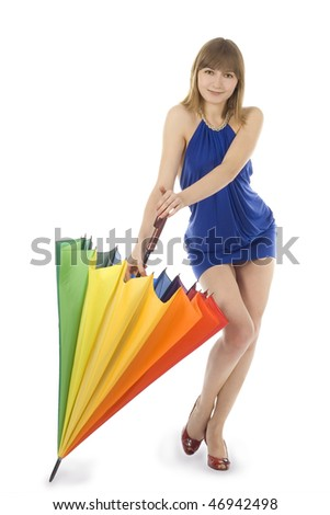 Lovely young green-eyes lady in blue dress standing with color umbrella