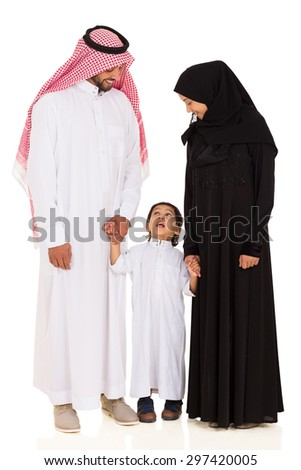 lovely young islamic family standing on white background - stock photo