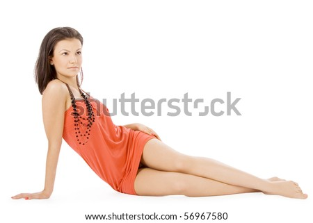 Lovely young lady in red dress lying isolated white background - stock photo