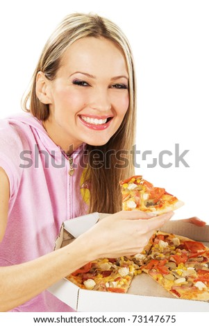 Lovely young woman eating a pizza - stock photo
