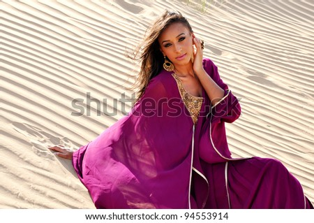 Lovely young woman in arabic desert
