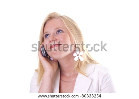 Lovely young woman listening at the phone with a loving smile - stock photo