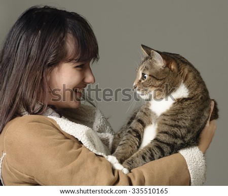 Lovely young woman loves her cat - stock photo