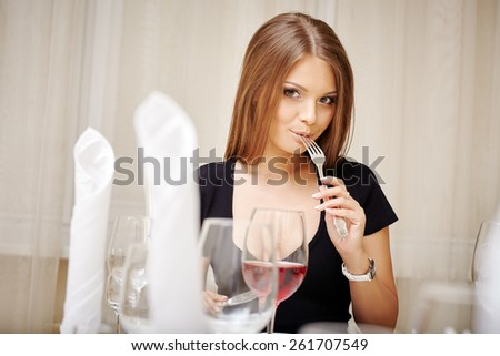 Lovely young woman posing during lunch - stock photo