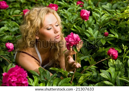 Lovely young woman relaxing on a garden - stock photo