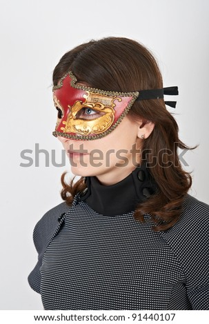 Lovely young woman with carnival mask - stock photo