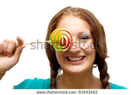 Lovely young woman with lolipop, on white background.