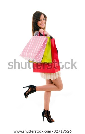 Lovely young woman with shopping bags over white background