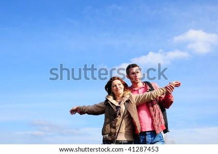 lover couple against sky - stock photo