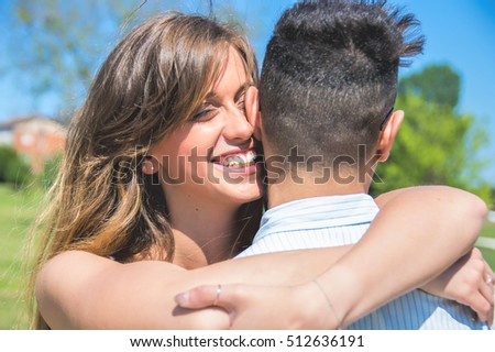 Lover girl hugging her boyfriend.
