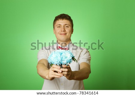 "Lover man ""nerd"" in a shirt and tie ""butterfly"" with a bouquet of flowers blue chrysanthemums. Parody"