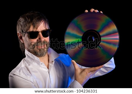 Lover of music with the retro laser disc. - stock photo