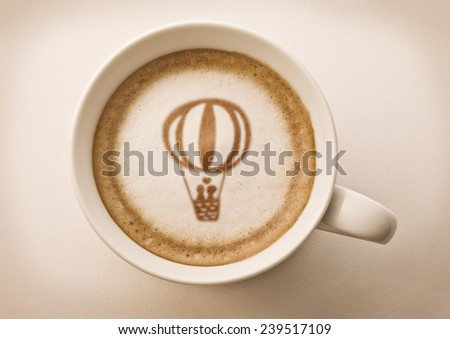 lover's balloon drawing on latte coffee cup - stock photo