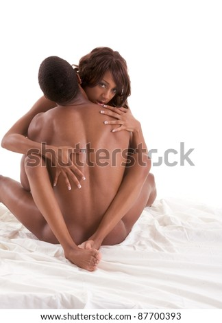 Lovers - African-American black sensual couple making love in bed - stock photo