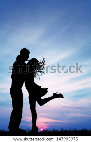 Lovers at sunset - stock photo