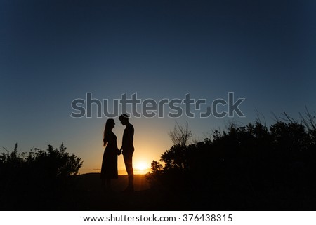lovers at sunset are facing each other. Love. Relations. Tenderness - stock photo