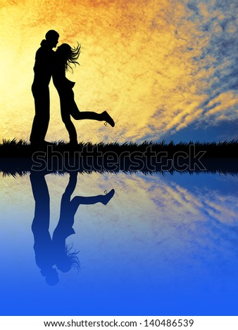 Lovers at sunset with reflection - stock photo
