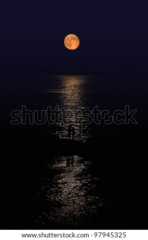 Lovers couple walking under the moonlight - stock photo