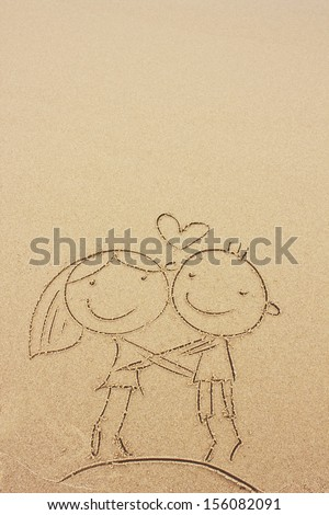 lovers drawn in the sand/Sea background /boy and girl smile drawing in the sand on the beach/Valentines day background - stock photo