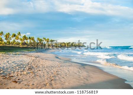 Lovers dream walk along Brazilan beach. - stock photo