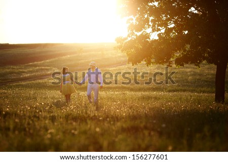Lovers holding at sunset