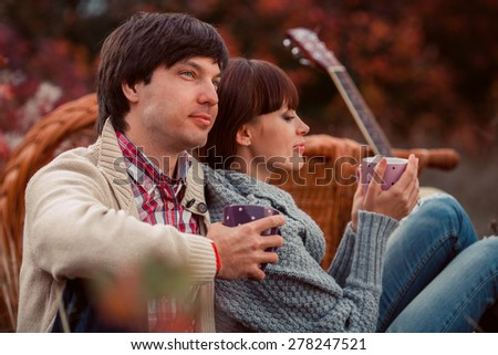 Lovers holding cups of tea - stock photo