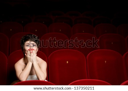 Lovers in a movie theater - stock photo