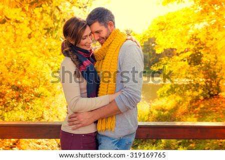 lovers in the seasonal park - stock photo