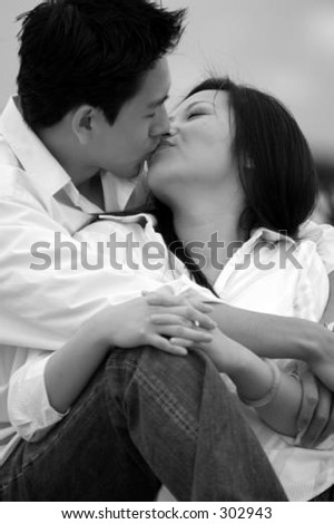 lovers kidding at beach black and white - stock photo