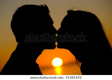 Lovers Kiss at Sunset - stock photo