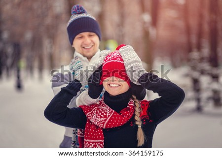 Lovers man and woman having fun and playing in winter Park. - stock photo