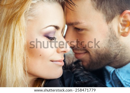 Lovers of young people enjoying each other's arms. Horizontal color image - stock photo