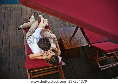 Lovers on the lounger - stock photo