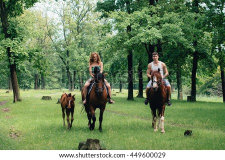 Lovers ride horses in the park