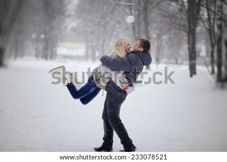 lovers walking in the park in winter