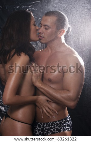 Loving affectionate nude heterosexual couple in shower hugging - stock photo