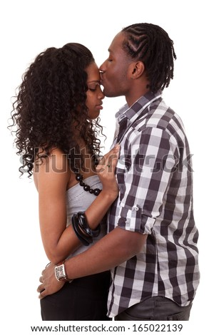 Loving african american couple kissing, over white background - Black people