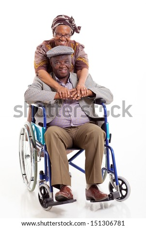 loving african wife hugging disabled husband on white background - stock photo