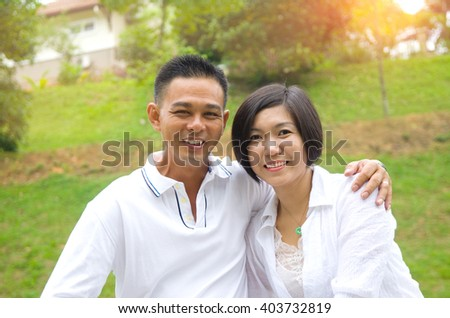 Loving asian Couple at outdoor park - stock photo