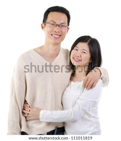 Loving Asian Couple on white background - stock photo