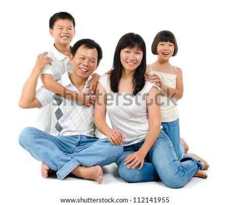 Loving Asian family on white background - stock photo