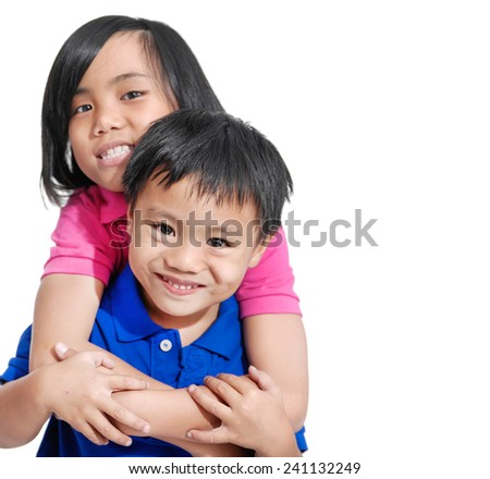 Loving brother and little sister hugging isolated
