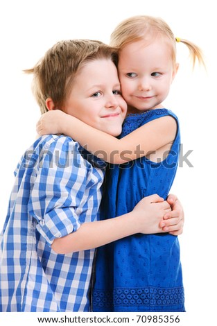 Loving brother and little sister hugging isolated over white