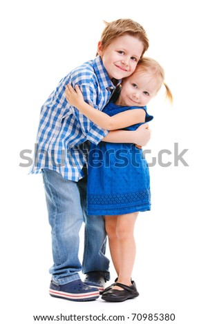 Loving brother and little sister hugging isolated over white - stock photo