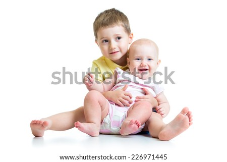 Loving brother hugging little sister  isolated on white - stock photo